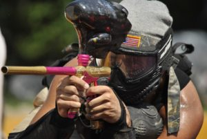 Man with paintball gun.