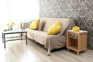 White futon with yellow cushions.