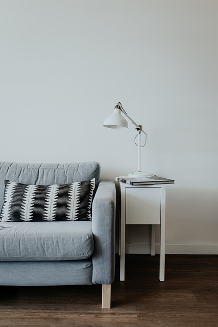 Futon with side table and lamp.