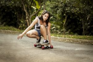 Girl doing skateboard trick.