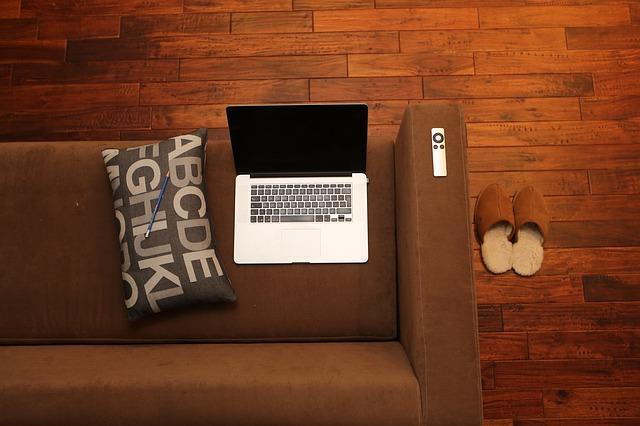 Computer on futon.