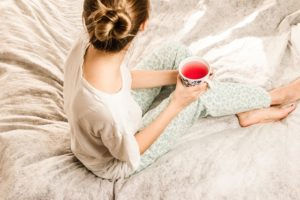 Woman relaxing with tea.