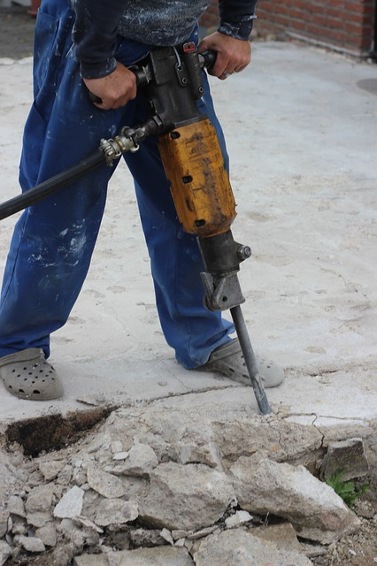Man using jackhammer.