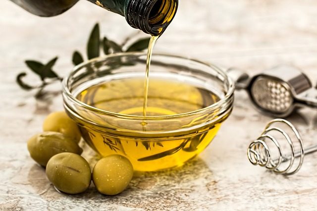 Olive oil poured in a bowl.