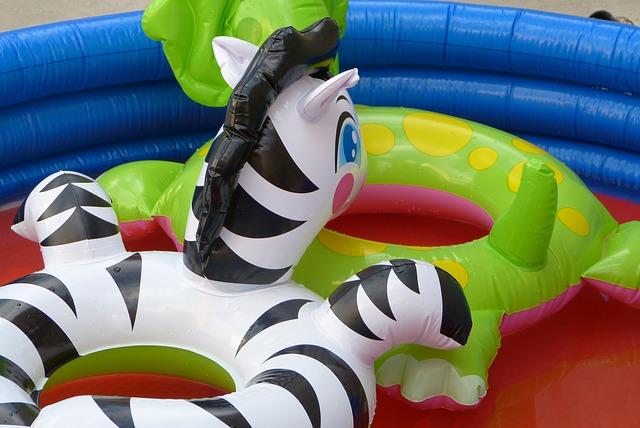 Zebra and dinosaur pool toys.