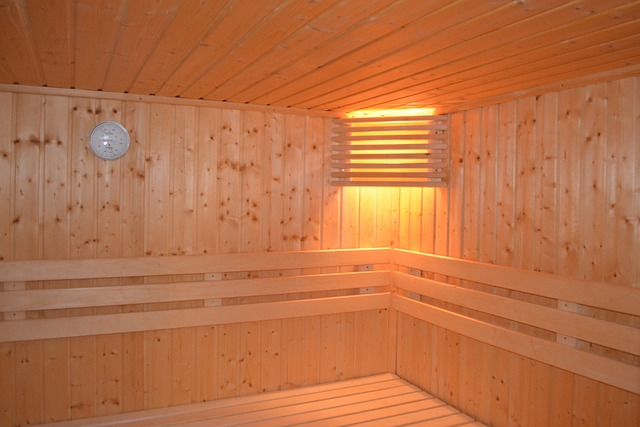 Inside of a sauna with a light in the corner.