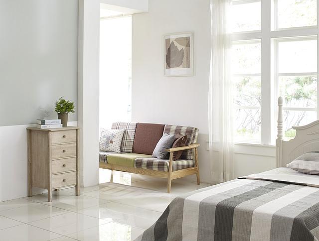 Clean, white bedroom.