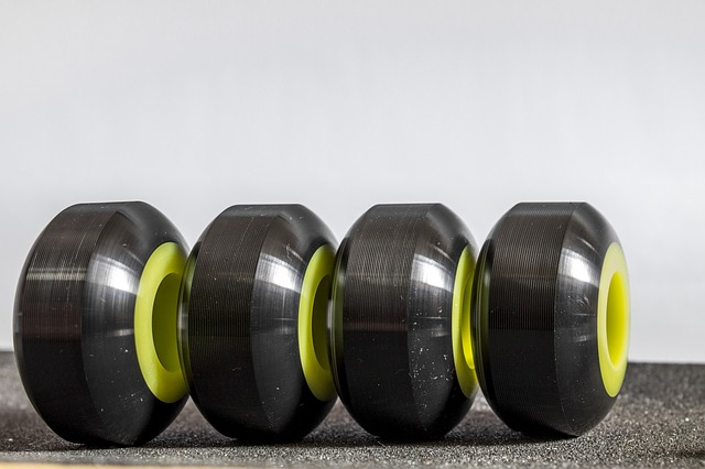 Four skateboard wheels lined up in a row for display.