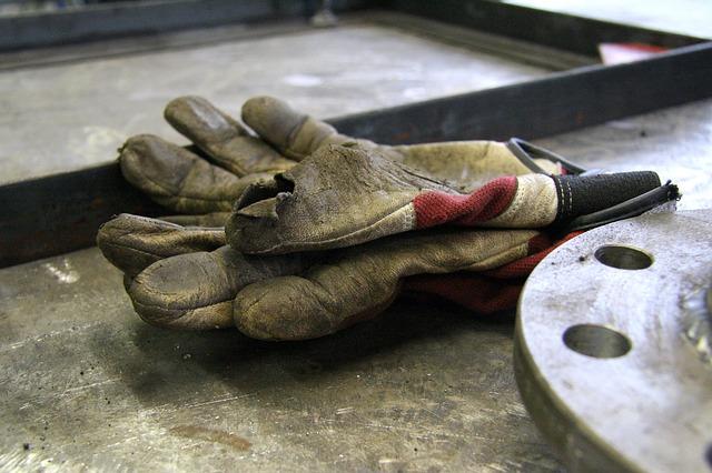 Work gloves on work bench.