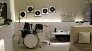 White room with drums.