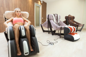 Three massage chairs and a girl.