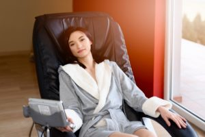 Woman sitting on a massage chair.
