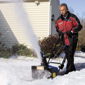 Man with snow blower.