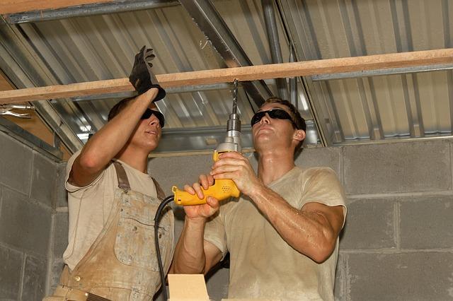 Men working on garage roof.
