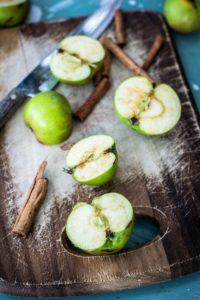 Green apples and cinnamon sticks.