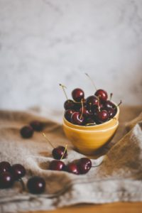 Cherries in a small bowl.